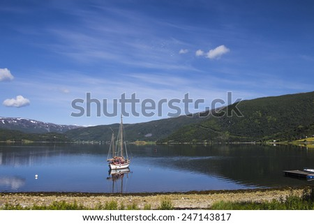 Yacht drifting on the water - stock photo