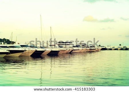 Yacht harbor with luxury boats in the sunset. - stock photo