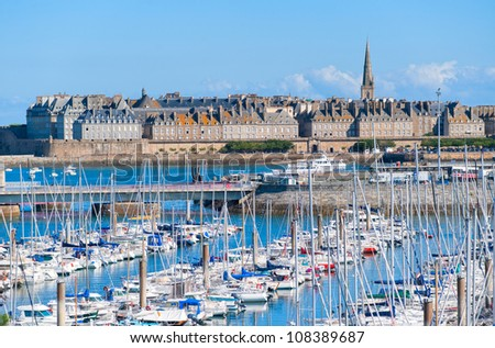 Yacht harbour and walled city of St Malo, Brittany, France - stock photo