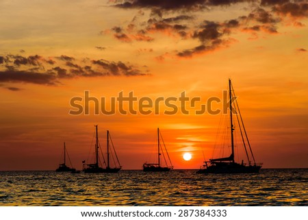 yacht in ocean before sunset - stock photo