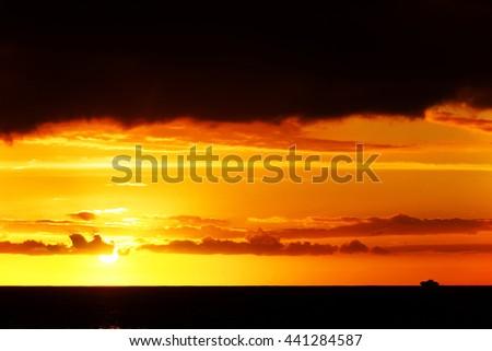 Yacht in sunset light - stock photo