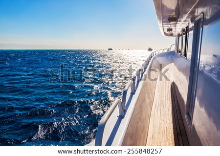 Yacht in the red sea at sunset. Beautiful summer seascape. Creative toning effect - stock photo