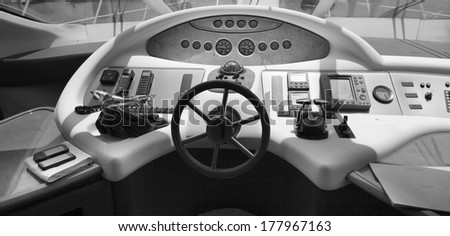 yacht marine equipment,  Instrument panel and steering wheel of a motor boat cockpit - stock photo