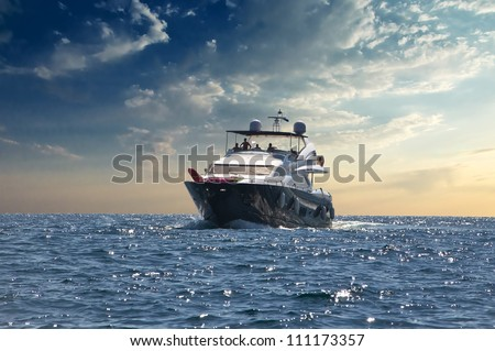 yacht moving in sea against sky - stock photo