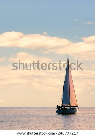 Yacht of the sea sunrise. Seascape with a sailboat of pastel colors. Vacation on the sail yacht. Romantic trip of the sail. - stock photo