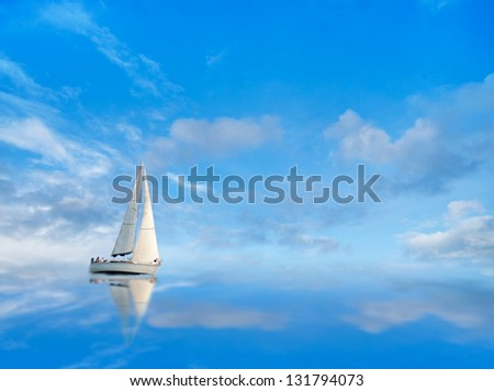 Yacht on blue sky reflected in calm water - stock photo