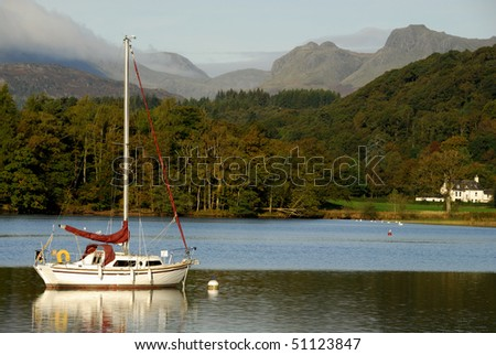 Yacht on Lake Windermere,  Langdale Pikes in the background, English Lake District - stock photo