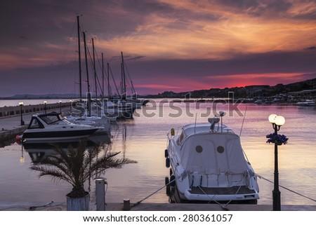 Yacht on the marina at sunset - stock photo
