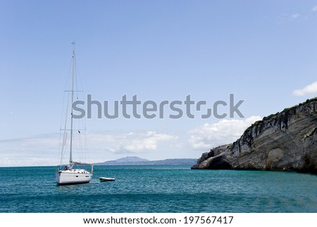 Yacht on the Mediterranean Sea at coast of Greece. - stock photo