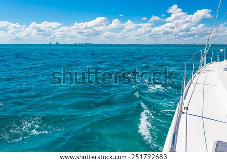 Yacht on the ocean with blue sky and turquoise water  - stock photo