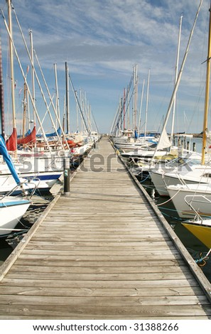 yacht or motor boat at harbor moored at jetty in denmark - stock photo