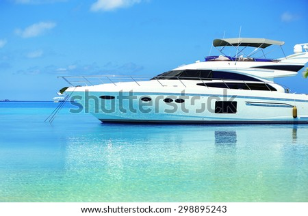 Yacht parked at jetty in Baros Maldives - stock photo