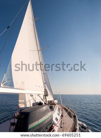 Yacht sailing in the sea - stock photo