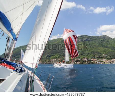 "Yacht under sail. Tivat, Montenegro - 26 April, 2016 Regatta ""Russian stream"" in God-Katorskaya bay of the Adriatic Sea off the coast of Montenegro. - stock photo"