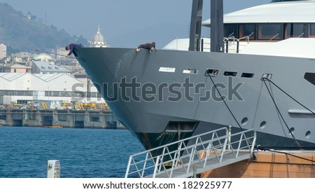 yacht washing with water and detergent products - stock photo