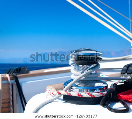Yacht. Yachting. Sailboat Winch and Rope Yacht detail. - stock photo