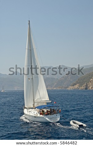 Yachting in Marmaris Bay against mountainous landscape - stock photo