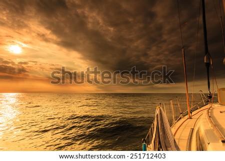Yachting yacht sailboat sailing in baltic sea at sunset sunrise summer vacation. Tourism luxury lifestyle. - stock photo