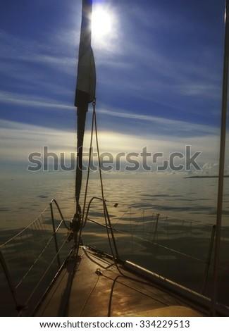 Yachting yacht sailboat sailing in baltic sea at sunset/ sunrise summer vacation. Tourism luxury lifestyle. - stock photo