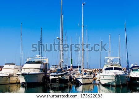 Yachts and boats anchored at a marina. Sailing Boats - stock photo