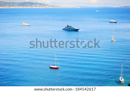 Yachts and boats in sea bay. French Riviera, Azure Coast or Cote d Azur, Provence, France  - stock photo