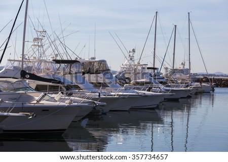 Yachts and motor boats at harbor moored at marina. Port  Stephens. Nelson Bay.  Australia. - stock photo
