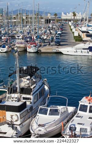 Yachts and sailboats at Port Olimpic marina in Barcelona, Catalonia, Spain. - stock photo