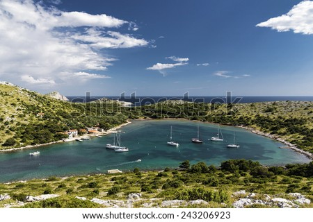 Yachts in a natural sea bay - Kornati National Park - Croatia - stock photo