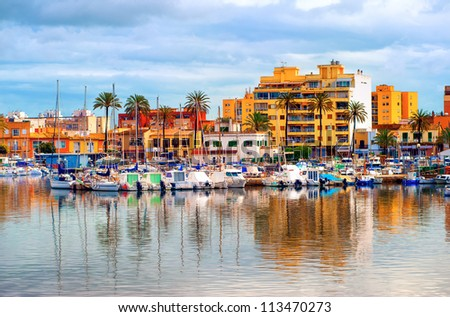 Yachts in front of apartment village in Palma de Mallorca, Majorca, Spain - stock photo