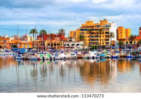 Yachts in front of apartment village in Palma de Mallorca, Majorca, Spain - stock photo