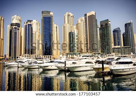 Yachts in the bay near skyscrapers in Dubai Marina - stock photo