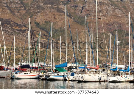 Yachts moored in a marina in Hout Bay, Cape Town, South Africa. - stock photo