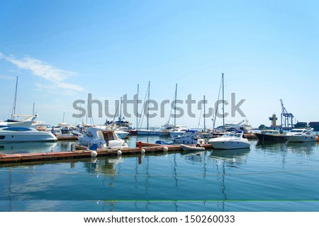 Yachts moored in seaport in beautifull sunny day. Odessa Ukraine. - stock photo
