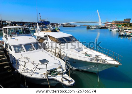 Yachts parked by the dock of Taiwan Fisherman's Wharf. - stock photo