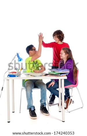Yaeh, solving a math problem. Three students are working on a math problem. - stock photo