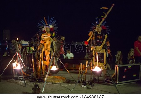 YALTA - AUG 23: Performers in costume Indians playing music in the street on August 23, 2013 in Yalta, Ukraine. - stock photo