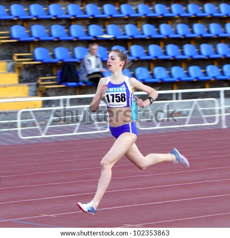 YALTA, UKRAINE - APRIL 25: Tsarik Marina - the winner of 1500 meters race for girls age 16-17, on Ukrainian Junior Track and Field Championships on April 25, 2012 in Yalta, Ukraine. - stock photo
