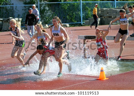 YALTA, UKRAINE - APRIL 27: unidentified girls compete in the 2000 Meter Steeplechase for girls age 16-17 on Ukrainian Junior Track and Field Championships on april 27, 2012 - Yalta, Ukraine. - stock photo