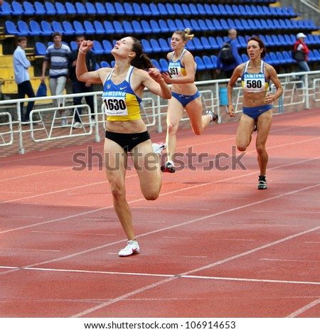 YALTA, UKRAINE - JUNE 01:(L-R) Kolesnichenko Olena, Slusarenko Katerina,  Lebed Anastasia compete in the 400 meters race on Ukrainian Track & Field Championships on June 01, 2012 in Yalta, Ukraine - stock photo