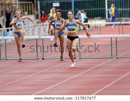 YALTA, UKRAINE - JUNE 01:(L-R) Slusarenko Katerina, Lebed Anastasia, Kolesnichenko Olena compete in the 400 meters race on Ukrainian Track & Field Championships on June 01, 2012 in Yalta, Ukraine - stock photo