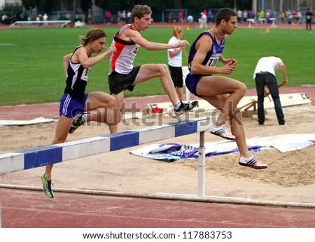 YALTA, UKRAINE - JUNE 01: Unidentified men at the finish of the 3,000 meters race on the Ukrainian Track & Field Championships on June 01, 2012 in Yalta, Ukraine. - stock photo