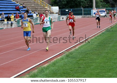 YALTA, UKRAINE - MAY 25:(L-R) Aleksandr Karpenko, Yan Sloma, Bekmezdzhi Suleiman, Kondrashov Artem on international athletic meet between UKRAINE, TURKEY and BELARUS on May 25, 2012 in Yalta, Ukraine. - stock photo