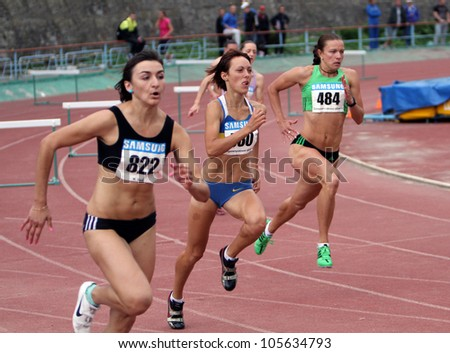 YALTA, UKRAINE, MAY 28: (L-R) Nikonenko Viktoria, Lebed Anastasia, Titimets Anna compete at the 400 meters race on Ukrainian Cup in Athletics, on May 28, 2012 in Yalta, Ukraine . - stock photo