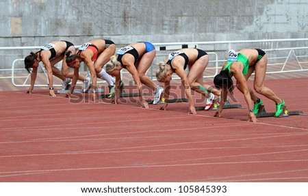YALTA, UKRAINE - MAY 28: (L-R) Sinisa Ina, Kuzminok Oksana, Mohnuk Nastia, Fedorova Alina, Melnichenko Anna compete in heptathlon on Ukrainian Cup in Athletics on May 28, 2012 in Yalta, Ukraine. - stock photo