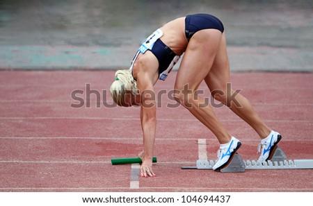 YALTA, UKRAINE, MAY 29: Pigida Natalia on the start at the relay race on Ukrainian Cup in Athletics, on May 29, 2012 in Yalta, Ukraine . - stock photo