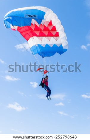 Yalutorovsk, Russia - May 24, 2008: Sport airdrome. Paratrooper girl descends and trains in landing accuracy - stock photo