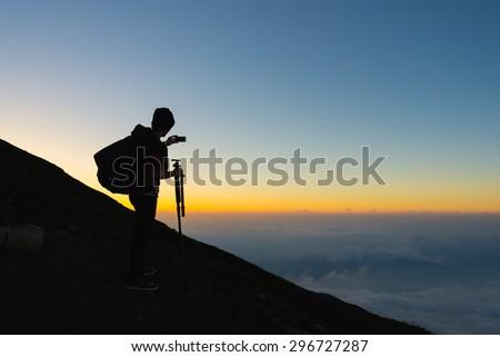 YAMANASHI, JAPAN - JULY 26 : Hikers gather during sunrise on the Mt. Fuji summit on july 26, 2014 in Yamanashi, Japan - stock photo