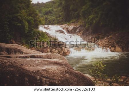 Yang Bay  Vietnam waterfall, 48 km from Nha Trang, consists of three sets of falls -- Yang Bay, Yang Khang, and Ho Cho. It's a well-developed tourist spot  - stock photo