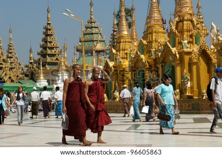 YANGON, MYANMAR - FEB 25: Pilgrims at Shwedagon Festival in Yangon, Myanmar on February 25, 2012. The festival has been held the first time since Aung San Suu Kyi used the site for a speech in 1988. - stock photo