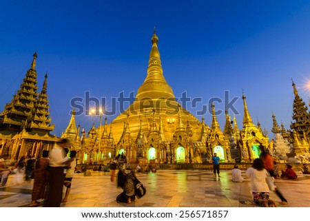 YANGON, MYANMAR-FEB 22: The Shwedagon Pagoda on February 22, 2014, in Yangon. It is one of the most famous pagoda in the world and the main attraction of Yangon, locally known as Shwedagon Zedi Daw. - stock photo